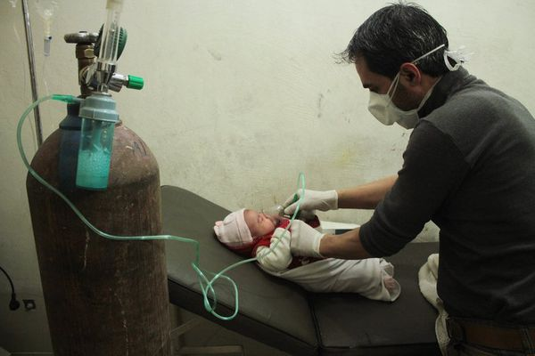 An infant is treated for respiratory distress after a chlorine gas attack in Aleppo, Syria, in December 2016. (The New York Times)