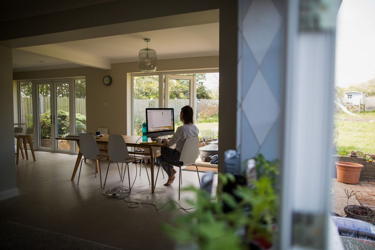 Experts are concerned the future mix of home and office work will be complicated to manage. (Bloomberg photo by Chris Ratcliffe)