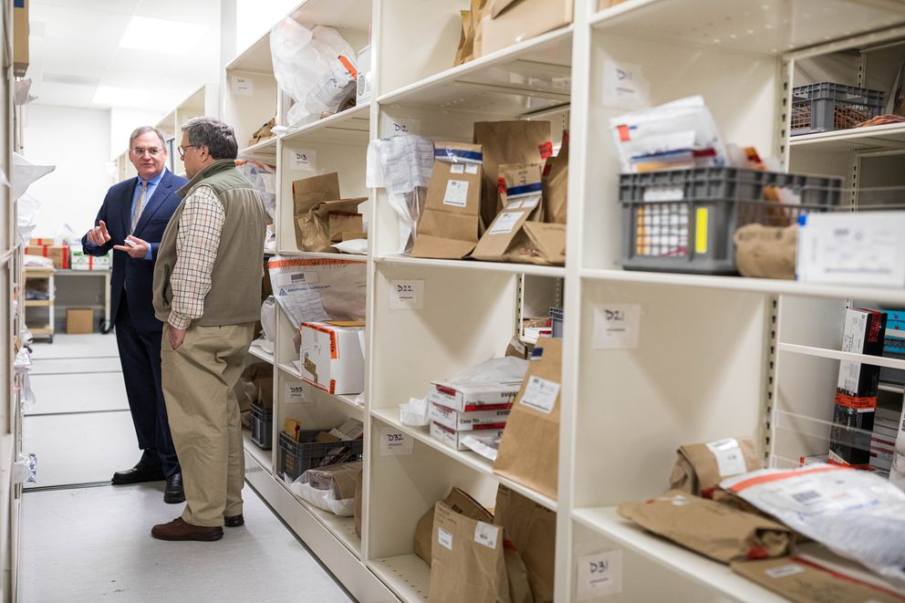 Alaska State Crime Lab manager Orin Dym gives U.S. Attorney General William Barr a tour of the evidence storage area. (Loren Holmes / ADN)
