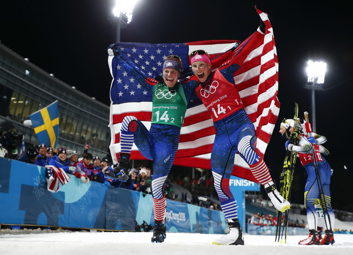 United States' Jessica Diggins, left, and Kikkan Randall celebrate after winning the gold medal in the women's team sprint freestyle cross-country skiing final at the 2018 Winter Olympics in Pyeongchang, South Korea, Wednesday, Feb. 21, 2018. (AP Photo/Matthias Schrader)