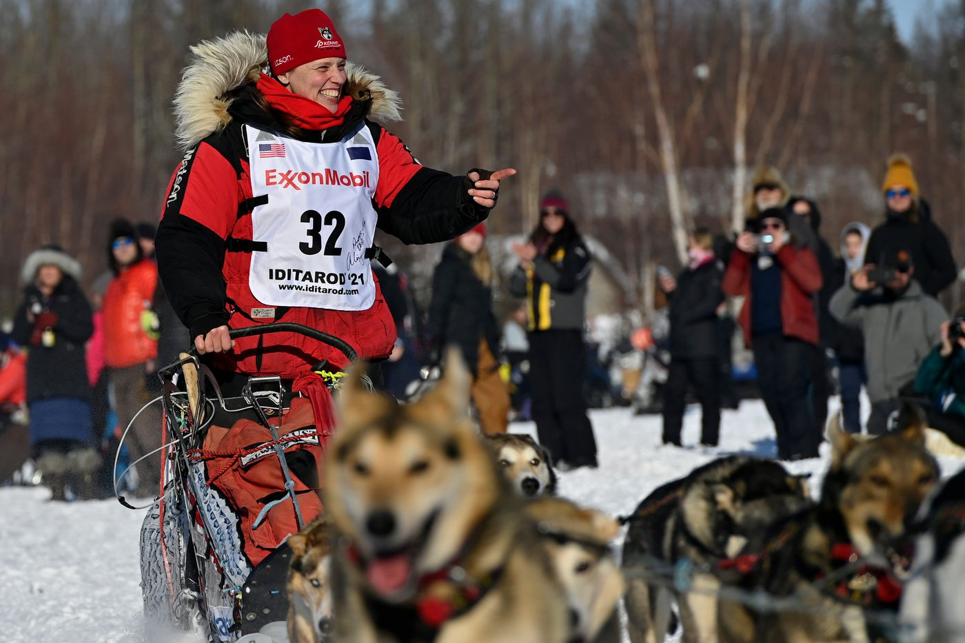 Aliy Zirkle, of Two Rivers, greets fans as she passes by. Zirkle says this is will be her last Iditarod start. (Marc Lester / ADN)