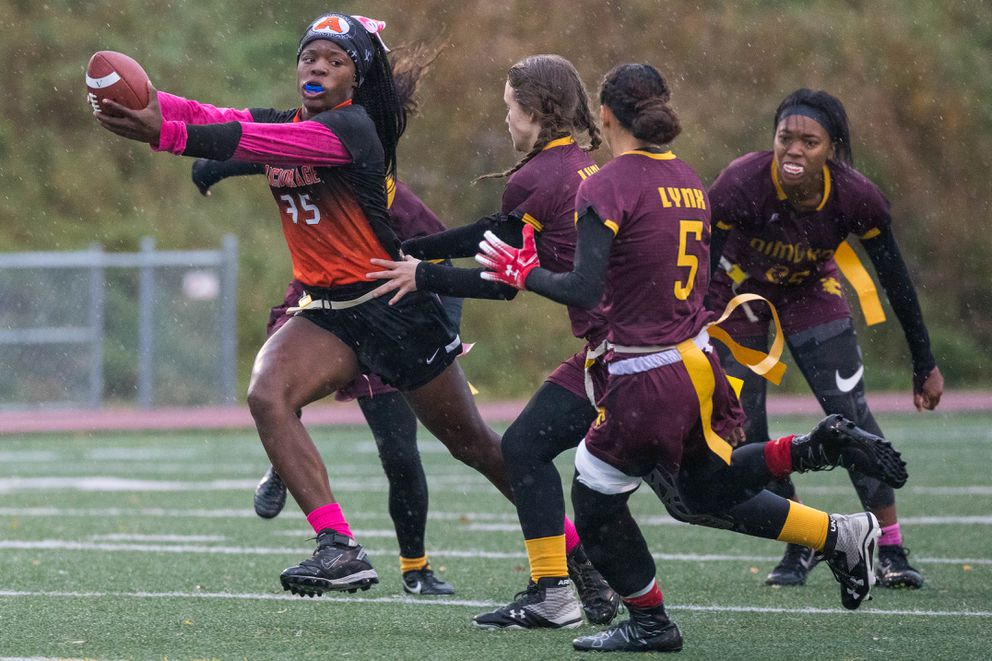 West's Ariana Harris runs the ball during the state flag football championship against Dimond Saturday. (Loren Holmes / ADN)