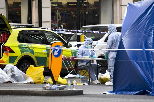 Forensic workers attend the scene on London Bridge in London, Saturday, Nov. 30, 2019. UK counterterrorism police on Saturday searched for clues into how a man imprisoned for terrorism offenses before his release last year managed to stab several people before being tackled by bystanders and shot dead by officers on London Bridge. Two people were killed and three wounded. (AP Photo/Alberto Pezzali)