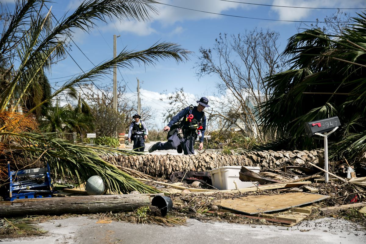 FEMA Urban Search and Rescue Team members search a damaged neighborhood on Big Pine Key Fla., in the Keys, Sept. 12, 2017. (Sam Hodgson/The New York Times)