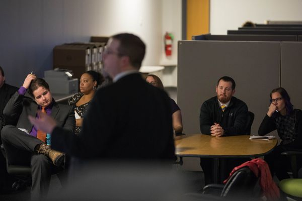Pretrial enforcement officers sit in a pretrial risk assessment tool training Tuesday, Dec. 12, 2017 at the pretrial enforcement division offices in Anchorage. Pretrial is a new system where some defendants are placed in the community while they await resolution of their criminal case. (Loren Holmes / ADN)