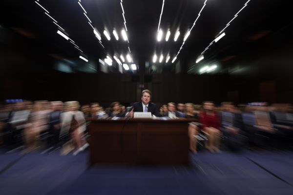 FILE - In this Thursday, Sept. 6, 2018 file photo made with a slow shutter speed and a zoom lens, President Donald Trump's Supreme Court nominee, Brett Kavanaugh testifies before the Senate Judiciary Committee on Capitol Hill in Washington, for the third day of his confirmation hearing. On Thursday, Sept. 20, 2018, an attorney for Christine Blasey Ford said she would testify to the Senate next week about her accusation that Kavanaugh assaulted her when both were high school students if agreement can be reached to