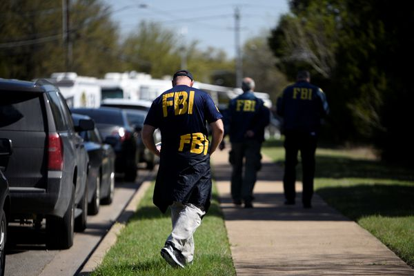 FBI agents walk towards a crime scene on Mission Oaks Boulevard following an explosion in Austin, Texas, U.S., March 19, 2018. REUTERS/Sergio Flores
