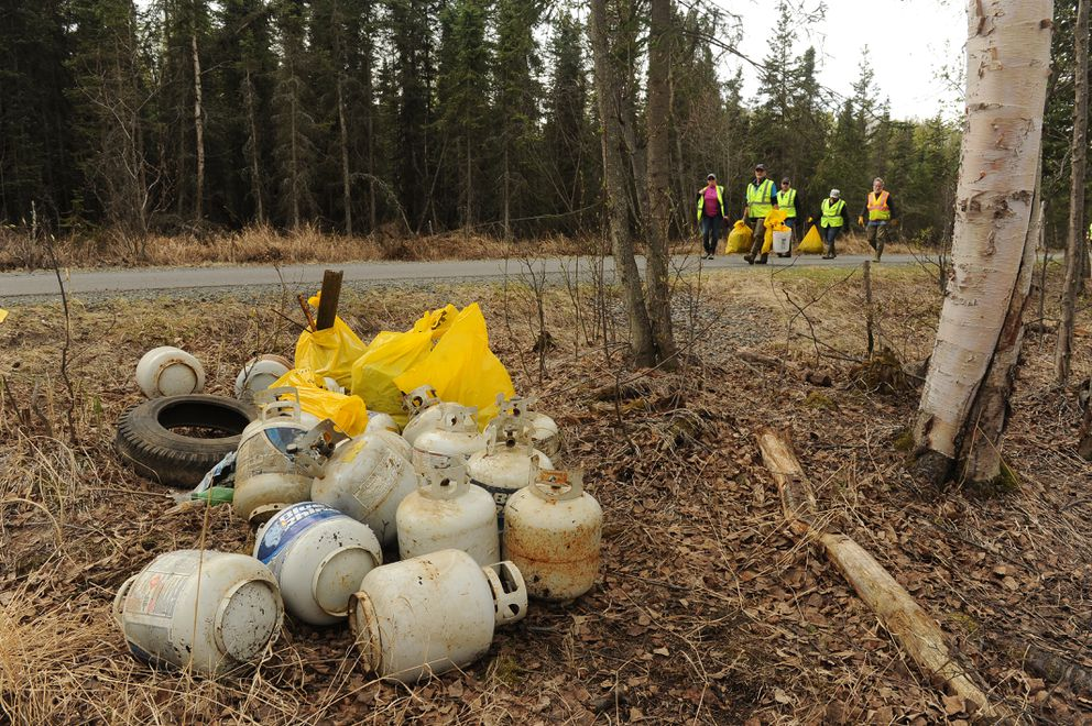 A pile of propane tanks was pulled out from near Chester Creek on Saturday. (Bob Hallinen / ADN)