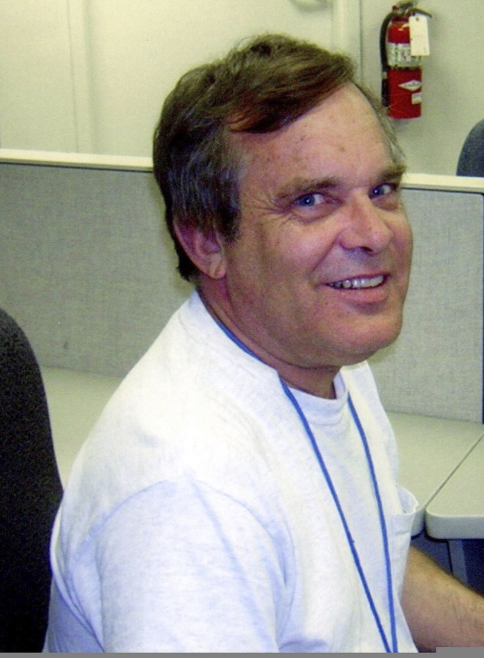 In this 2013 photo provided by Susan E. Madsen, Alan Naiman poses for a photo at his work at Children's Administration Child Protective Services, in Seattle. (Susan E. Madsen via AP)