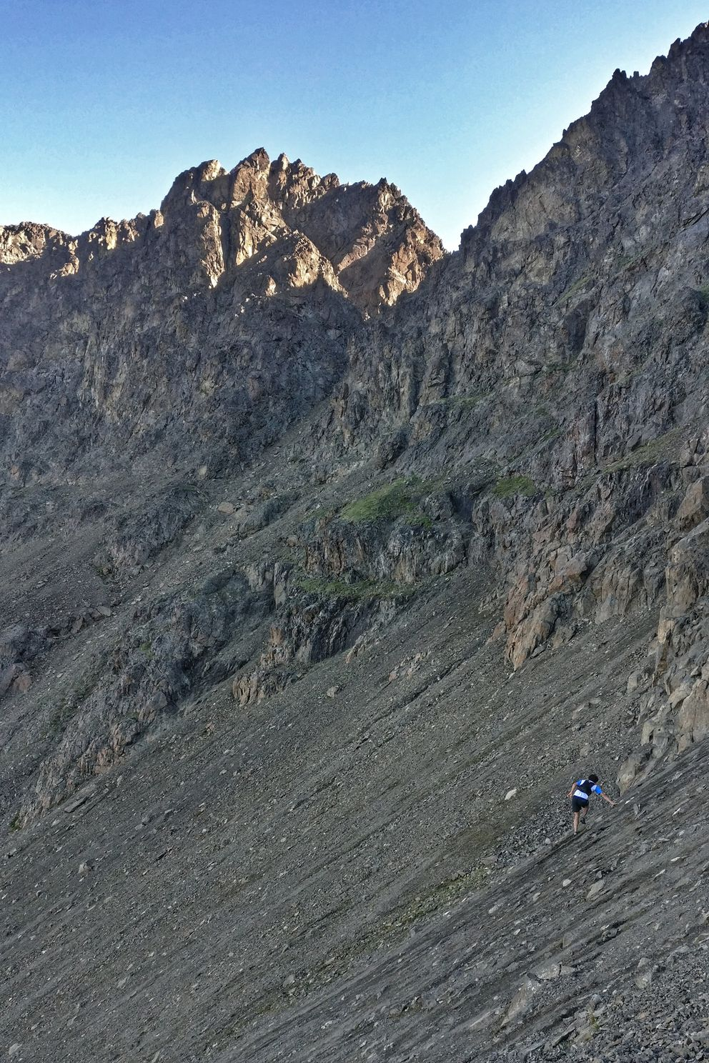 Peter Mamrol navigates scree on his way between The Ramp and Hidden Peak, two of the 12 peaks he and Lars Arneson climbed in a single day earlier this month. (Photo by Lars Arneson)
