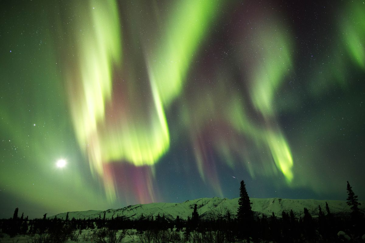Seen from Eureka, Alaska, a coronal mass ejection from the sun created stunning northern lights a few days later as the particles passed by earth on Mar. 16, 2013. (Loren Holmes / Alaska Dispatch News)