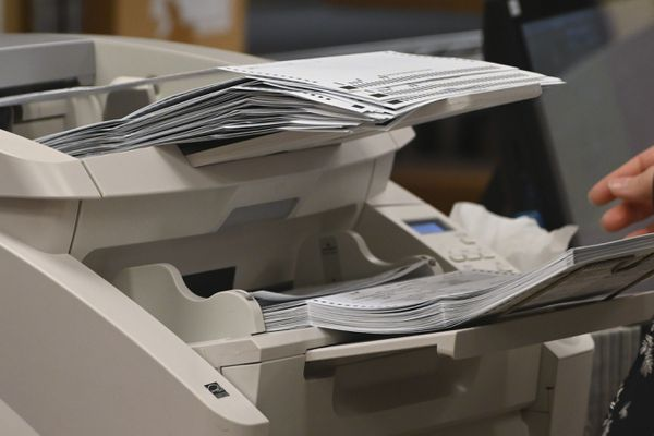 Absentee ballots being scanned for tabulation at the Division of Elections Region II office in Anchorage on Tuesday, Nov. 10, 2020. (Bill Roth / ADN)