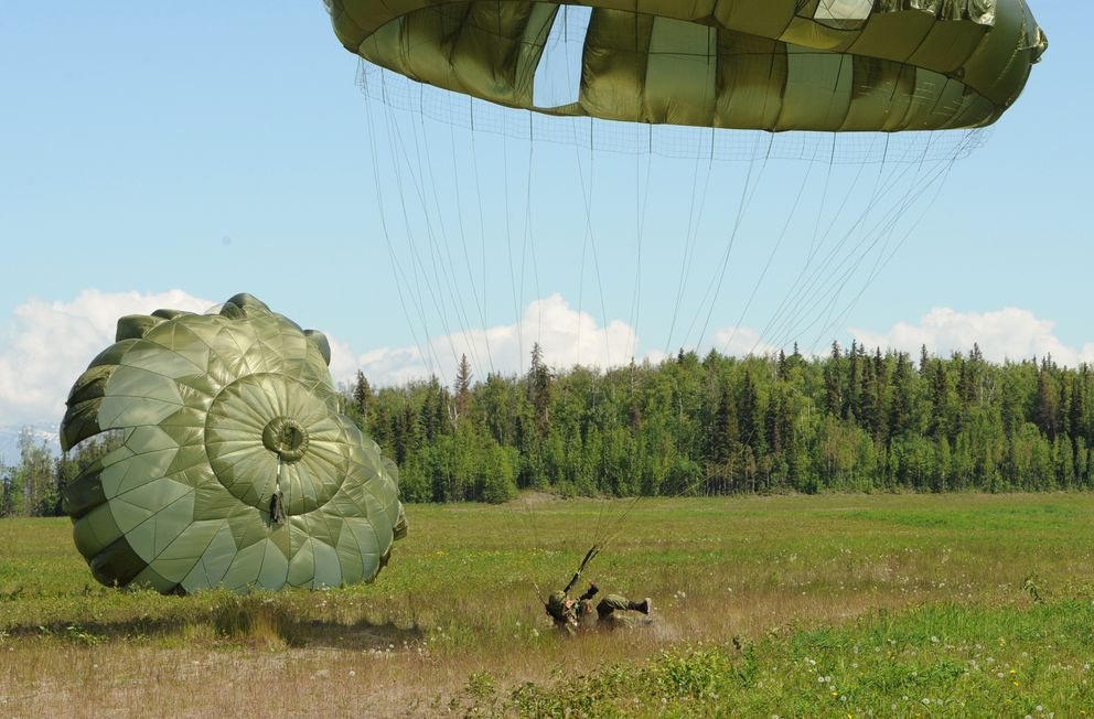 A paratroopers from the 1st Airborne Battalion, 1st Airborne Brigade, Japanese Ground Self-Defense Force lands at the Malemute Drop Zone on Joint Base Elmendorf-Richardson on Monday, June 10, 2019, while taking part in the joint exercise Arctic Aurora. (Bill Roth / ADN)