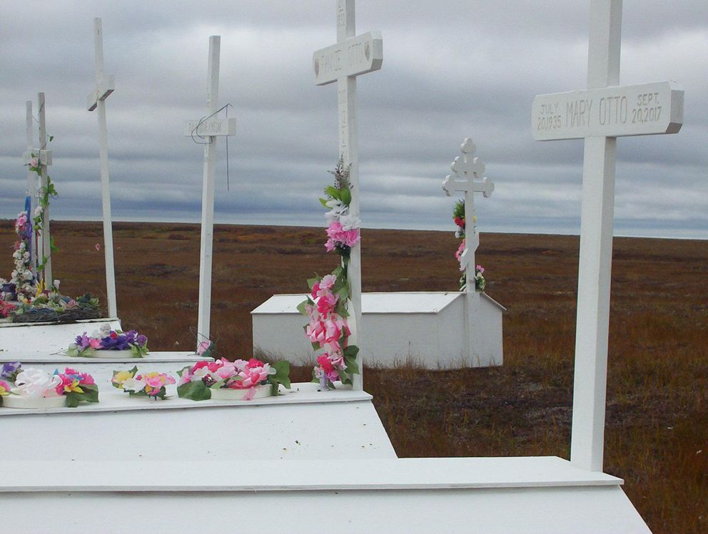 The newer graves in Kong's cemetery have been placed on higher ground. (Teresa Cotsirilos / KYUK)