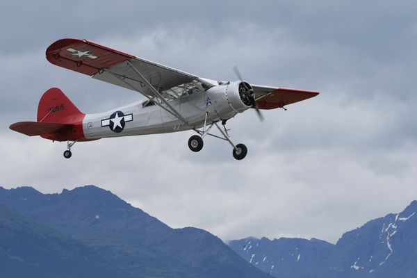 The Alaska Aviation Museum's 1941 Stinson L-1, a single engine high wing military observation plane that was assigned to the 11th Air Force at Fairbanks and Anchorage, is piloted by Terry C. Holliday as it takes flight from Merrill Field on Wednesday, July 27, 2016. (Bill Roth / Alaska Dispatch News)