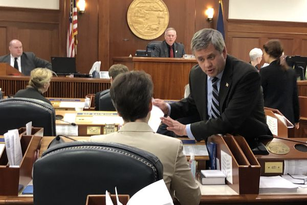 Rep. Chris Tuck, D-Anchorage, talks about a proposed amendment to the coronavirus emergency-powers act with Rep. Sarah Vance, R-Homer, on Thursday, March 26, 2020 in the Alaska State Capitol. (James Brooks / ADN)