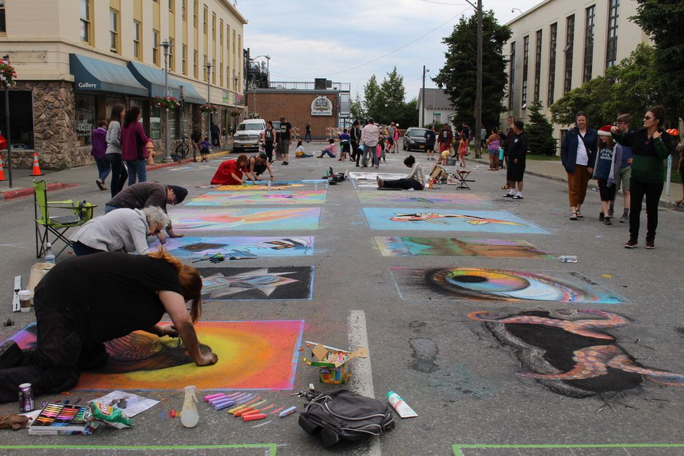 Professional artists and festival goers draw with chalk on G Street during the Downtown Summer Solstice Festival. June 22, 2019 (Photo by Lauren Ellenbecker)