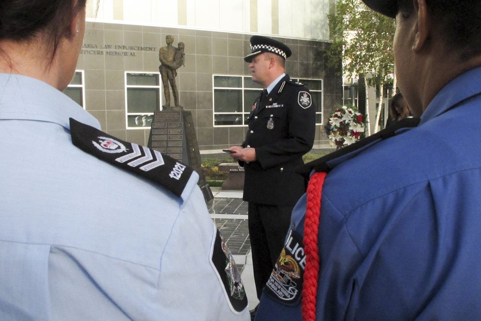 Superintendent Conrad Jensen of the Australian Federal Police speaks at a police remembrance ceremony Friday. (AP Photo/Rachel D'Oro)