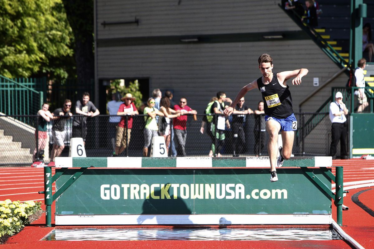 Isaac Updike of Ketchikanleapsover thewater pit en route to victory at the Oregon Twilight Meet last monthin Eugene. (Photo by Josh Philips)
