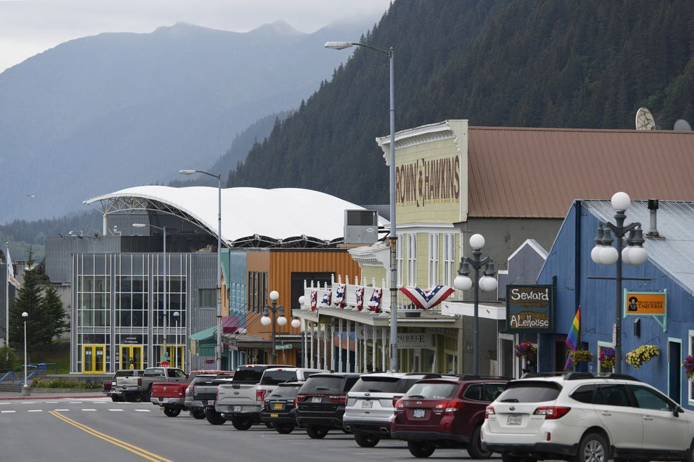 The Alaska SeaLife Center, lower left, seen on July 6, 2020, in downtown Seward, Alaska. Zoos and aquariums from Florida to Alaska are struggling financially because of closures due to the coronavirus pandemic. three-quarters of past visitors to the Alaska SeaLife Center, an aquarium and research center that runs Alaska's only marine mammal rescue program, have been tourists who arrive by plane or cruise ship. With most cruises canceled, there are few people to see the octopus, and the site's rare Steller sea lions. (Marc Lester/Anchorage Daily News via AP)