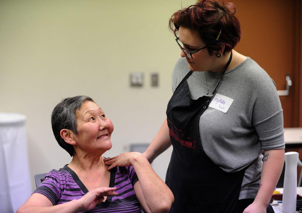 Mykala Bailey, from Studio FX, cuts Susanna Osness' hair Wednesday. (Bob Hallinen / Alaska Dispatch News)