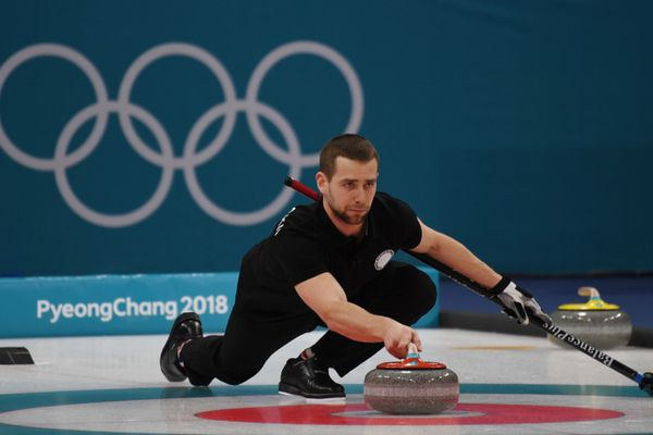 Feb 13, 2018; Gangneung, South Korea; Aleksandr Krushelnitckii (OAR) during the mixed doubles curling bronze medal game during the Pyeongchang 2018 Olympic Winter Games at Gangneung Curling Centre. Mandatory Credit: James Lang-USA TODAY Sports