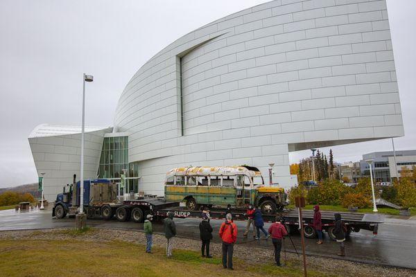 Bus 142 is in front of University of Alaska Museum of the North en route to the conservation yard, Sept 24, 2020. UAMN Director Pat Druckenmiller and Angela Linn, UAMN Senior Collections Manager for Ethnology and History, speak with press. (Photo by Roger Topp / UA Museum of the North)