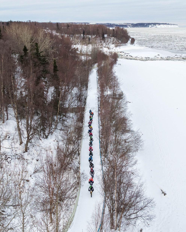 A string of bikers travels past Fish Creek. (Loren Holmes / ADN)