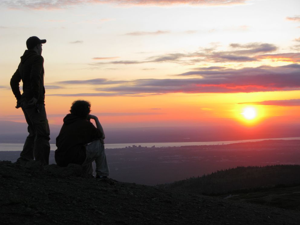 Hikers take in the sunset at about 11:30 p.m. on the summer solstice, Friday, June 20, 2008, on Flattop Mountain in Chugach State Park. (Marc Lester / ADN archive)