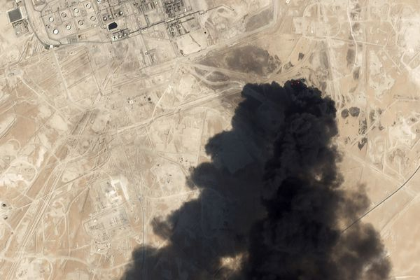 FILE - This Saturday, Sept. 14, 2019, satellite image from Planet Labs Inc., shows thick black smoke rising from Saudi Aramco's Abqaiq oil processing facility in Buqyaq, Saudi Arabia.The weekend drone attack on one of the world's largest crude oil processing plants that dramatically cut into global oil supplies is the most visible sign yet of how Aramco's stability and security is directly linked to that of its owner -- the Saudi government and its ruling family. (Planet Labs Inc via AP, File)