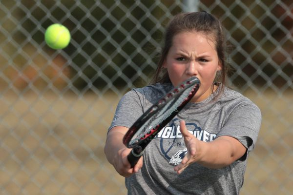 Eagle River's Irish Wolfe returns the ball to South's Madison Griffin during a tennis match Wednesday, Aug. 28, 2019 at Begich Middle School. (Loren Holmes / ADN)