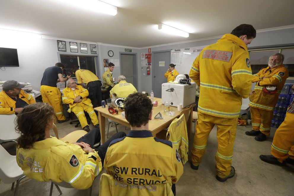 Firefighters standby as nearby fire threatens at the Burragate, Australia, firehouse, Friday, Jan. 10, 2020. (AP Photo/Rick Rycroft)
