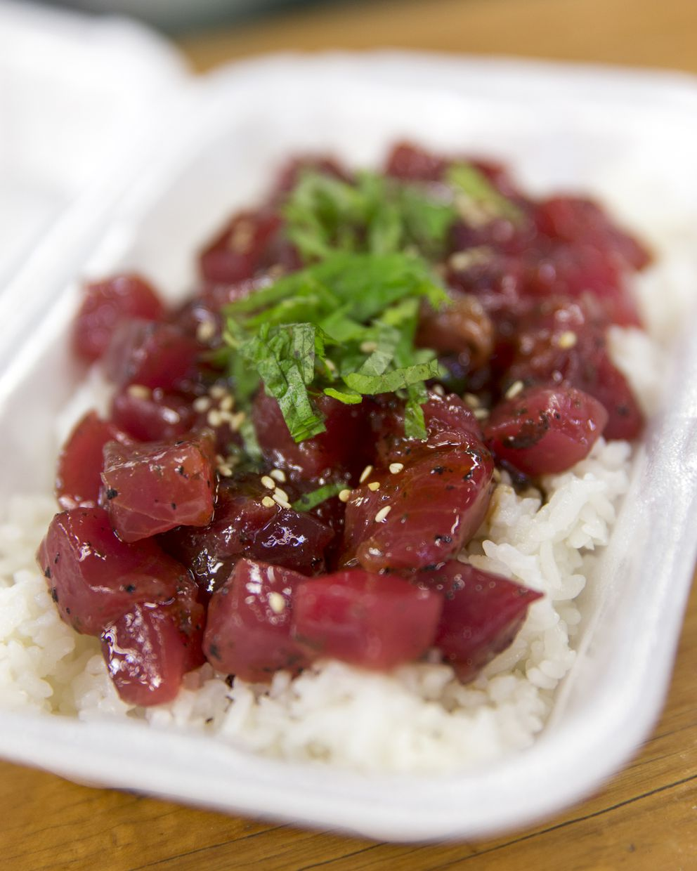 Ume-shiso ahi poke on a bed of rice at Maguro Brothers, in Chinatown's Kekaulike Market, Honolulu, Dec. 28, 2017. (Marco Garcia/The New York Times)