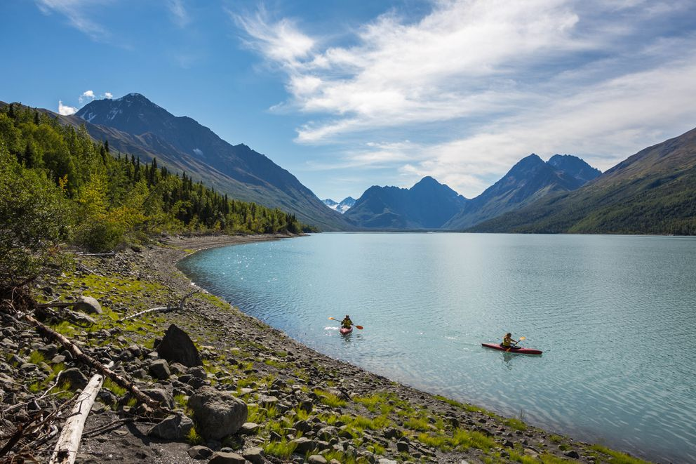 Lisa Sinnott and Anna Rix kayak in Eklutna Lake. (Loren Holmes / ADN)
