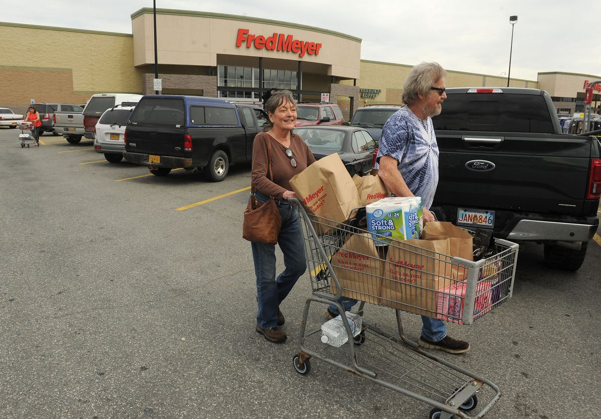 Diana and Paul Pesta wheel their paper bag filled cart to their truck at the Wasilla, AK Fred Meyer on Friday, July 13, 2018. The couple, from Talkeetna, is in favor of the plastic bag ban. (Bob Hallinen / ADN)