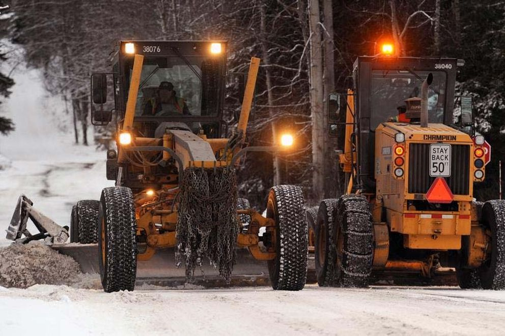 Snowplows work their way up and down East 24th Avenue just off Boniface Parkway. (Erik Hill / Anchorage Daily News / File)
