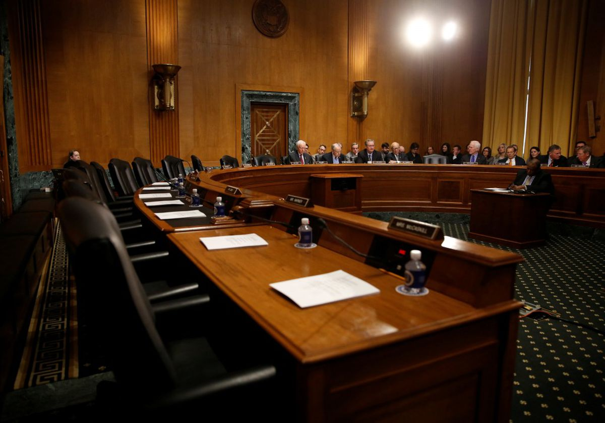 Democrats' seats are empty during a boycott of the Senate Finance Committee executive session on the nomination of Steven Mnuchin to be treasury secretary on Capitol Hill in Washington, February 1, 2017. REUTERS/Kevin Lamarque