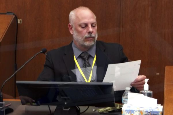 In this image from video, witness David Pleoger, a retired Minneapolis police sergeant reviews a document during testimony as Hennepin County Judge Peter Cahill presides Thursday, April 1, 2021, in the trial of former Minneapolis police Officer Derek Chauvin at the Hennepin County Courthouse in Minneapolis, Minn. Chauvin is charged in the May 25, 2020 death of George Floyd. (Court TV via AP, Pool)