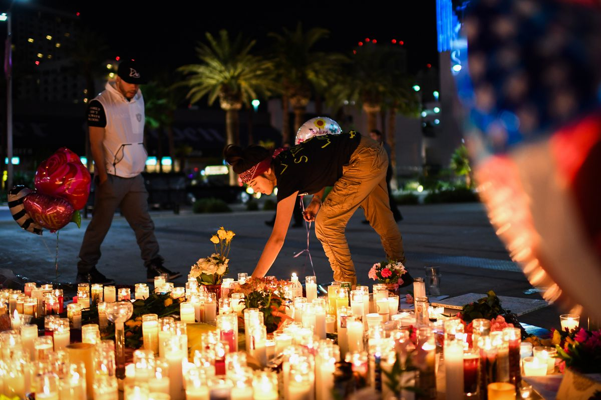 Priscilla Olivas lights a candle at a street vigil along the Las Vegas Strip on Monday. (Washington Post / Salwan Georges)