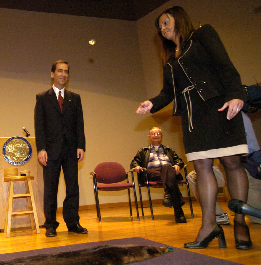 "The Democratic primary race between incumbent Representative Carl Moses and challenger Bryce Edgmon was settled by the flip of a coin on Sept. 25, 2006, at Loussac Library in Anchorage. Lt. Gov. Loren Leman, left, and Rep. Carl Moses, seated, who called ""heads,"" watched as state Division of Elections Director Whitney Brewster tossed a specially minted coin which landed on ""tails,"" giving Edgmon the election victory. (Bill Roth / ADN archive 2006)"