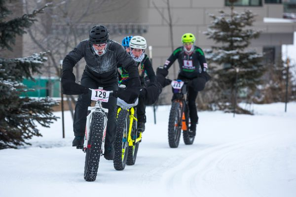 Ryan Thrasher leads a group of bikers up a hill at the Alaska Native Medical Campus during the the Frosty Bottom race on Saturday, Jan. 12, 2019. (Loren Holmes / ADN)