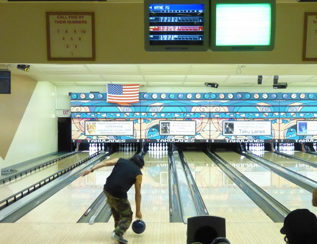 Wayne Fu Smallwood bowls at Taku Lanes in Juneau on Saturday. (Photo by Quinton Chandler  /KTOO)