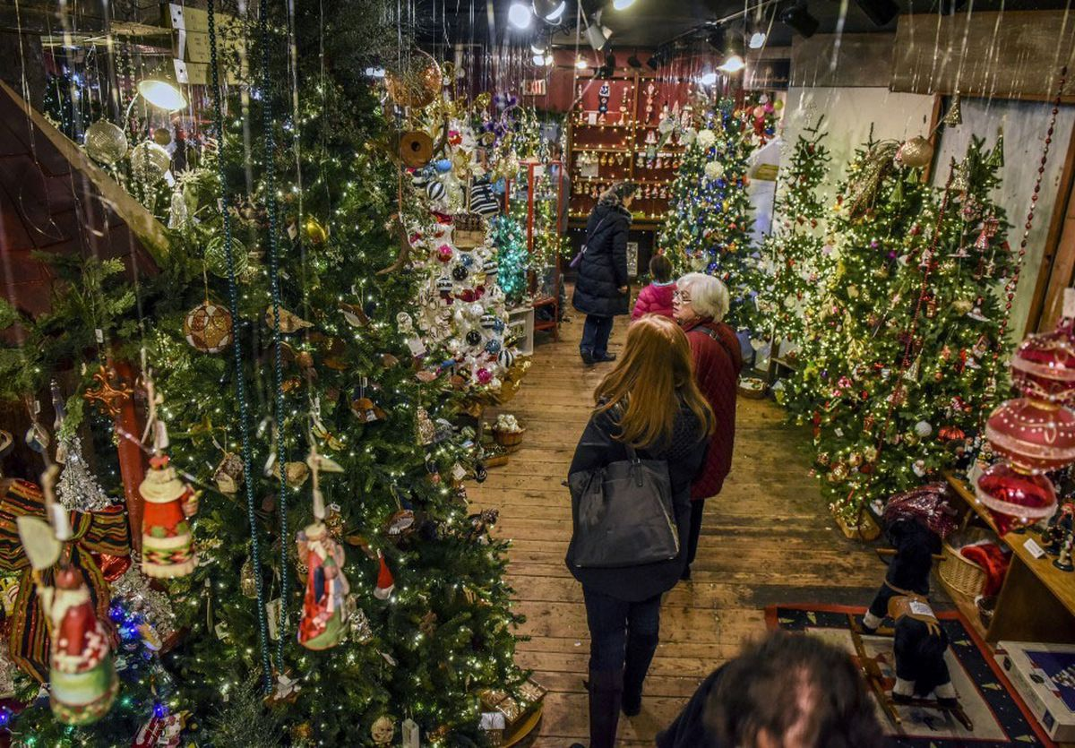 just days before christmas shoppers look for last minute decorations at the christmas attic - When Was Christmas Declared A National Holiday