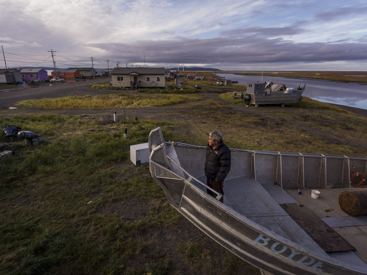 Edgar Jackson on his crabbing boat in Shaktoolik in 2016. Shaktoolik is one of 31 towns and cities in Alaska that may need to relocate because protective sea ice is vanishing, leaving shorelines exposed to erosion by fierce waves. (Josh Haner/The New York Times)