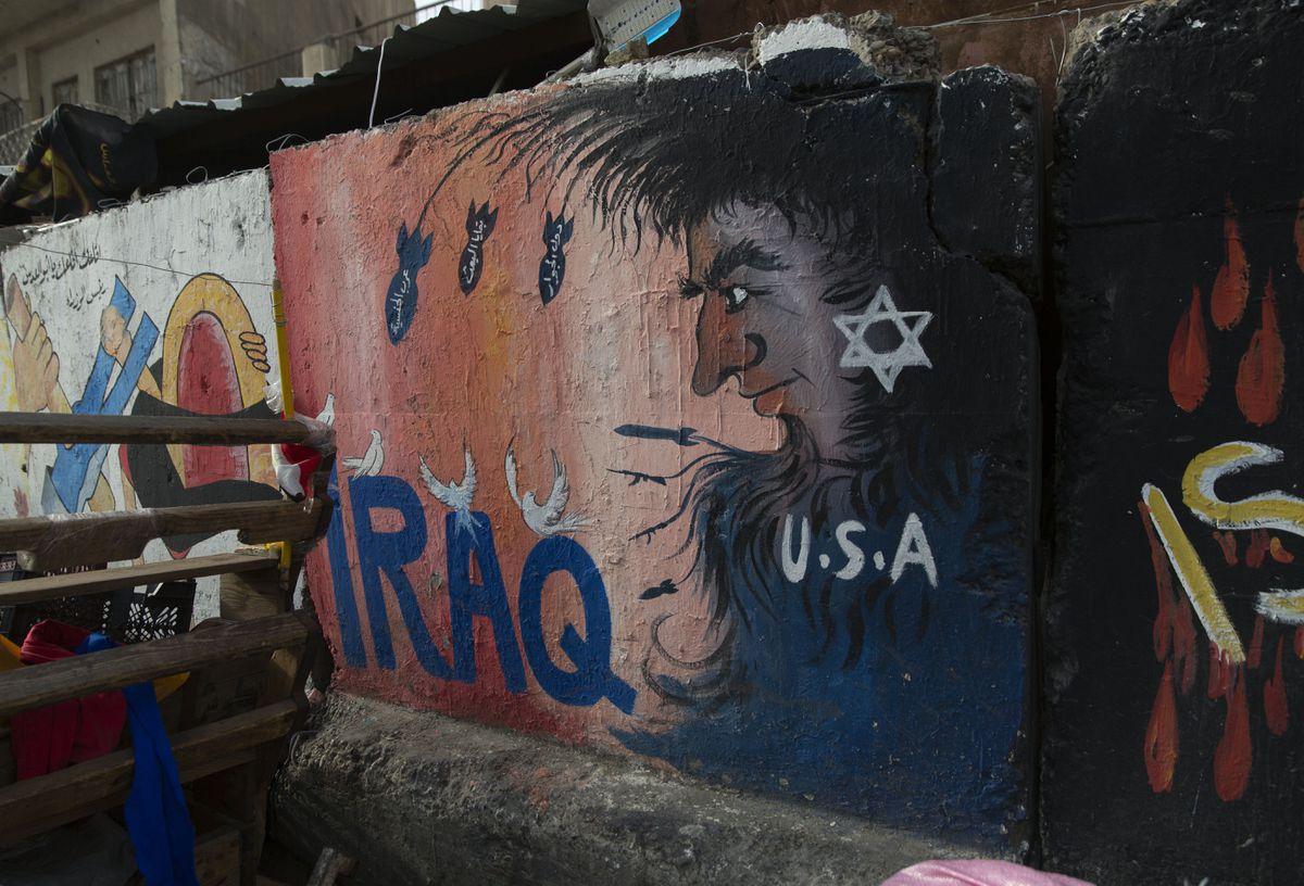 Graffiti adorns a wall in Tahrir Square, Baghdad, Iraq, Wednesday, Jan. 8, 2020. (AP Photo/Nasser Nasser)