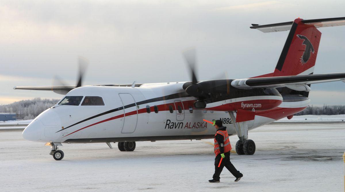 A Ravn Alaska de Havilland Dash 8 leaves the terminal at Ted Stevens Anchorage International Airport on Dec. 5, 2019. (Bill Roth / ADN archive)