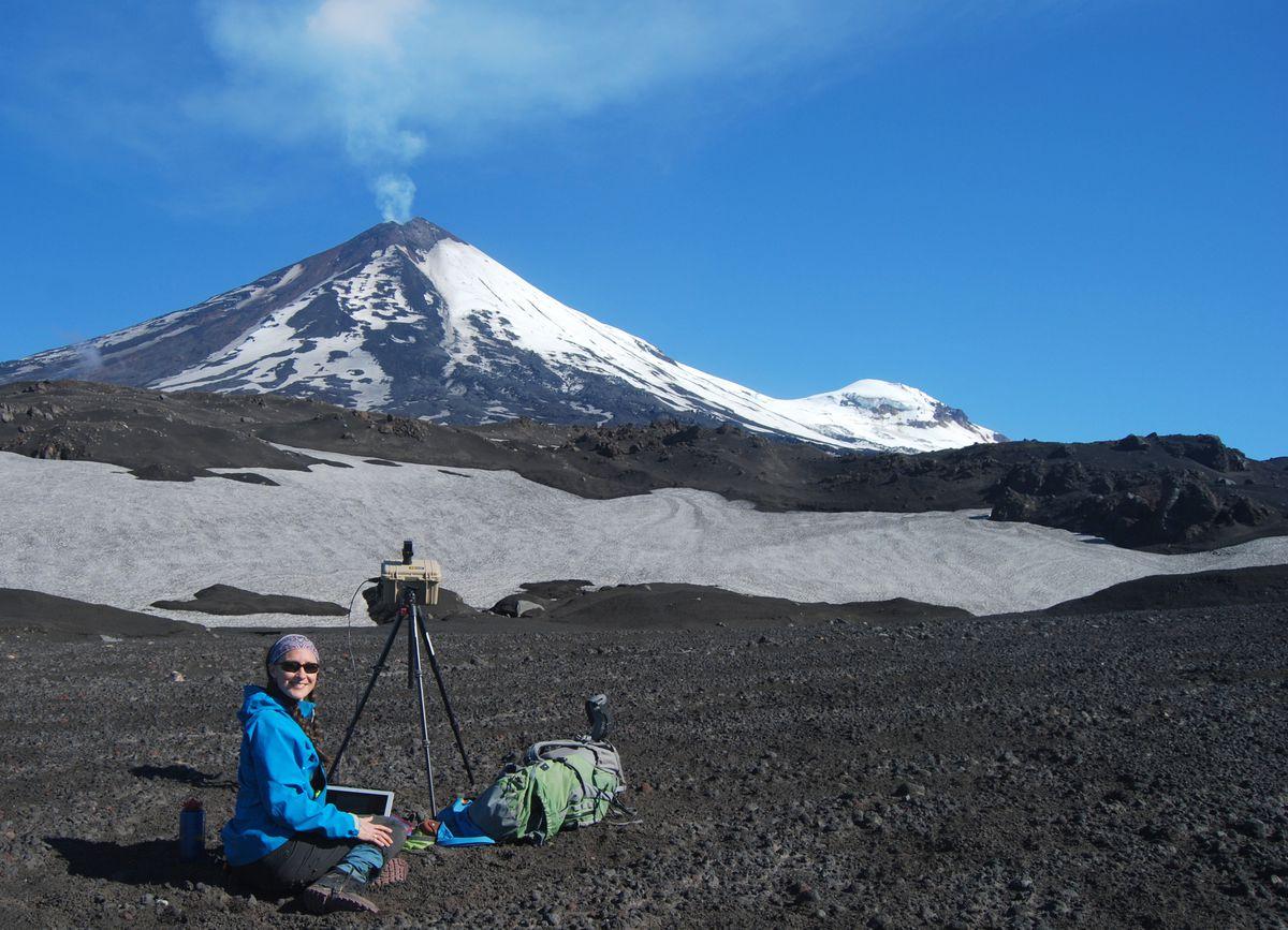Volcanologist Taryn Lopez near Pavlof Volcano on the Alaska Peninsula in 2017. (Photo by Pavel Izbekov)