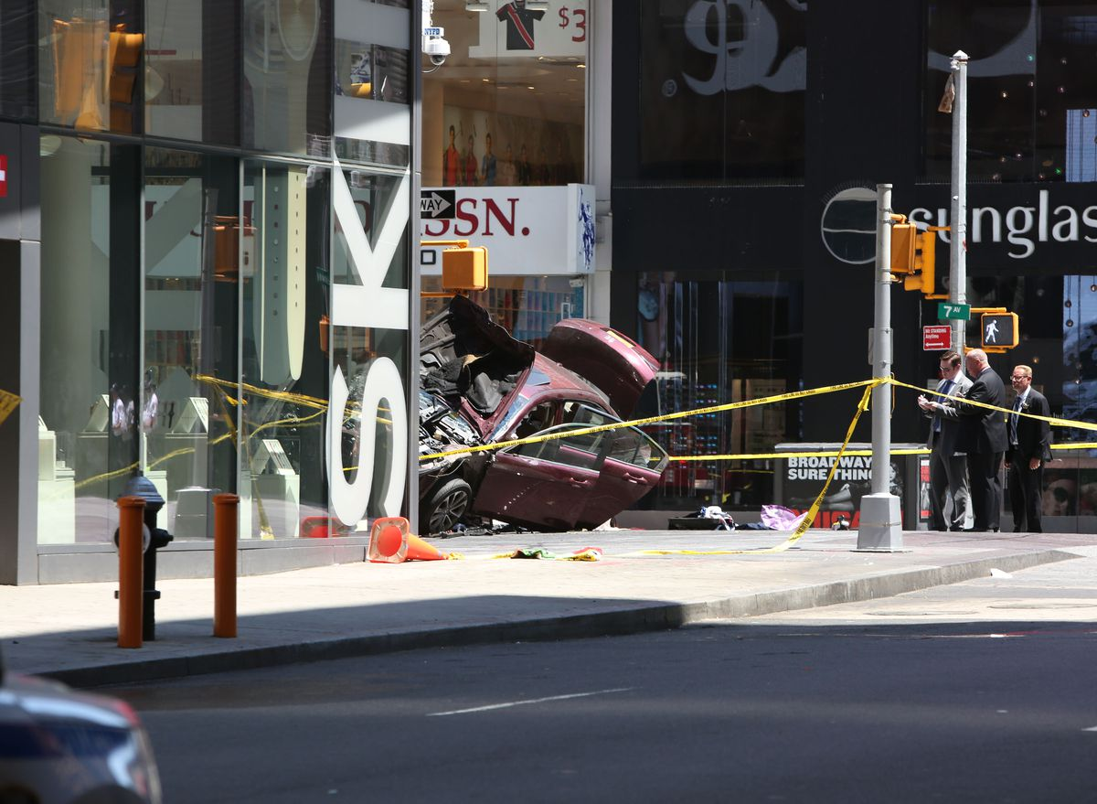 The sedan which plowed through a crowd of pedestrians, killing one and injuring at least 22, at Times Square in Manhattan, May 18, 2017. The driver, who has been taken into custody, appeared to have been either drunk or on drugs, a law enforcement official said; Mayor Bill de Blasio said there was no indication that it was an act of terrorism. (Earl Wilson/The New York Times)