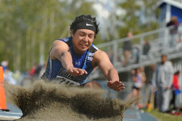 Ali Beya, of Thunder Mountain High, competes in the long jump during the Alaska State Track & Field Championships at Palmer High in Palmer, AK on Saturday May 26, 2018. (Bob Hallinen / ADN)
