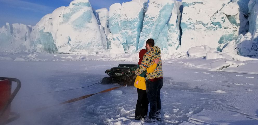 Josh Tills and girlfriend Taylor Wilson hug after they safely made it out of Tills' Jeep, which broke through ice near Knik Glacier on Jan. 26, 2020. (Photo by Scott Rees)